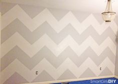 How to Paint a Chevron Wall - PERFECT easy to follow and the math makes sense for the wide stripes I want.