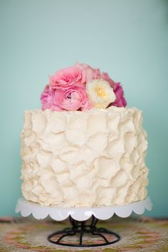 cream + pink floral wedding cake // photo by Studio Finch, flowers by Ipomea Floral, cake by Lovely: A Bake Shop // View more: http://ruffledblog.com/crochet-and-aqua-inspiration/