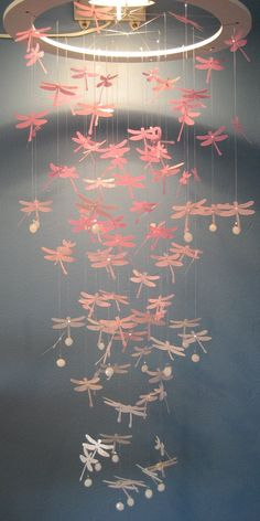 Dragonfly mobile/chandelier--I bet this would be easy to create. Could use shimmery or translucent paper to mimic dragonfly wings. Would make a nice gift.