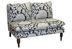 Armless Settee, with a floral design and carved spindle legs.