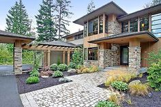 The style we like: Prairie/Northwest. Very open floor plans, high ceilings, with natural woods and stone throughout.