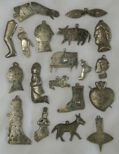 A choice lot of 19th and early 20th century silver milagros, largest measures approximately 2.25 inches.