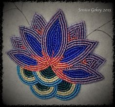 Main Water Flower on second piece for MNHS project. Flower measures about 6 inches by 6 inches. Designed and beaded by Jessica Gokey 2015