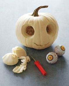 """How to create Zombie pumpkins. This is a cute alternative to traditional carved orange pumpkin jack-o'-lanterns and doesn't require a huge (a.k.a. expensive) pumpkin or a whole lot of carving or candle or artificial lighting. Includes mouth template, but better yet, create your own to individualize each Zombie's """"smile."""""""