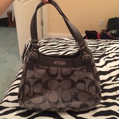 Silver coach bag Barely used. Has 3 huge sections each with 1 smaller pocket inside. 2 outside sections magnetically close & the inside one zippers. In perfect condition. NO TRADES. Coach Bags Shoulder Bags