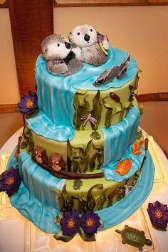Otter wedding cake.  OTTER WEDDING CAKE!  They're holding hands.  And there are owls!!  I want this cake