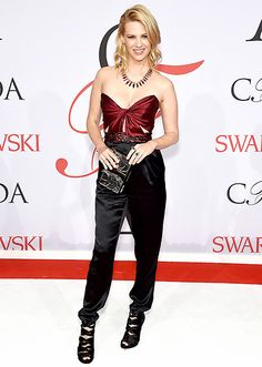 January Jones wowed in a bow-shaped bra top and black trousers, teamed with an Irene Neuwirth statement necklace.