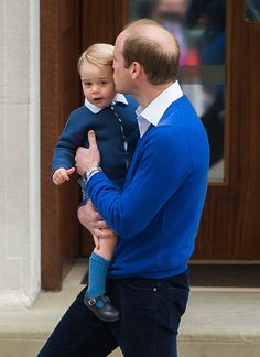 Encouraged by his father, little George waved to wave to the crowds who cheered and clapped as father and son arrived. William then gave his son a tender kiss on the head before they disappeared inside the hospital.