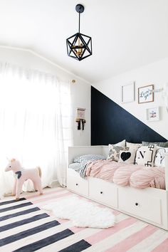 Clear and light child's room, with a block coloured walk to add depth.