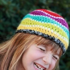Crocheted beanie with rainbow waves and a black/silver sparkly edge (washable!). Includes link to free pattern for you crocheters out there!