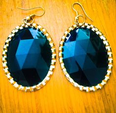Black stone studded Hanging earrings with Golden cut Border .Fashion Earrings suitable for Party, Function occasion, saree and tops.