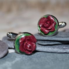 Welcome to Musa Natura, a place where you will find lots of handmade pieces inspired by Nature. Each one lovingly crafted by hand and made to order.  This listing is for a beautiful pair of Dark Red Rose Cuff links.  The Roses have been hand sculpted from Polymer Clay and set onto a Silver Tone Cuff link Base.  It is sized at 1.2 cm across. Your Cuff links will arrive presented in a little organza drawstring bag, wrapped in tissue paper.  My dispatch time is up to 5 working days as each item…