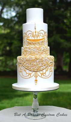 Classic colors and traditionally styled wedding cakes are perfect for a simple or vintage wedding. Yes, these cakes feature classic styles, but their understated details provide for a stunning wedding feature.