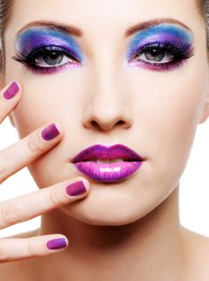 Multicolored make-up and beauty purple manicure