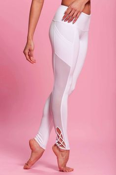 Popflex Pointe Legging | Snow White | Every girl grows up dreaming of becoming a ballerina one day, but for those of us who chose a slightly different path to run the world, you can still play dress up in these encore worthy Pointe Leggings!  | The criss cross detail on the side of the leg work their way up into a thigh high mesh panel before it hits our favorite part of this pant...the pockets!  | $76.00