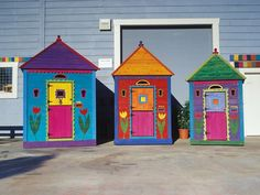 Fun Garden Shed Painted With Brightly Colored Wood Stains This