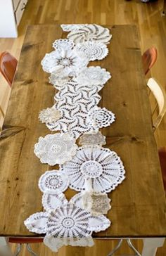Doily Table Runner Doily Table Runner - DIY Decorating Ideas This idea is genius. It's kind of like the old style crazy quilting only instead of fabric, you'll need a huge bunch of doilies. Grouping together a mix match of doilies is a fabulous decorating idea. Under the Sycamore demonstrates how simple it is to create a doily table runner.