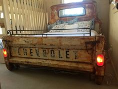 A Truck Bed Goes From Garage To Guest Room Repurposed Furniture Bed Garage Guest Room Truck Car Part Furniture, Automotive Furniture, Automotive Decor, Furniture Design, Office Furniture, Furniture Ideas, Furniture Removal, System Furniture, Furniture Websites