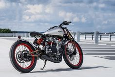 Hard to believe this this board tracker-style custom with a one-off girder fork…