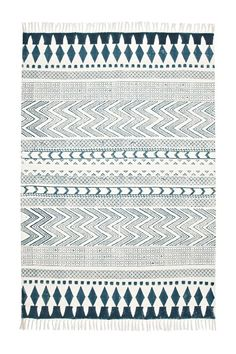 Block Printed cotton rug, French Connection, £75.  Lovely cotton rugs are less expensive than woollen ones, but you will need to get a thick underlay for them to make them feel cosy and stop them slipping.
