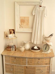 Sheet music/book page decoupaged dresser - leave edges exposed like this.  12 New Uses for Old Furniture | Interior Design Styles and Color Schemes for Home Decorating | HGTV