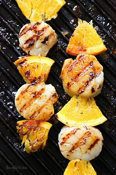 Grilled scallop and orange kebabs with honey-ginger glaze. Made indoors on a Lodge griddle!