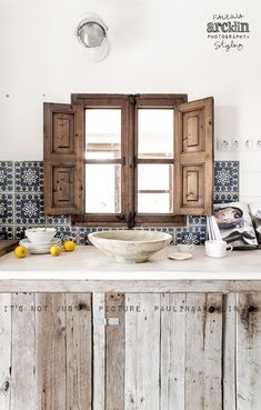 Spanish style tiles and rustic woods together.