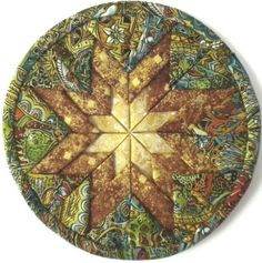 All you need is three fat quarters to create this Radiant Star Hot Pad/Table Mat. Free pattern is available
