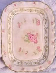 "222 Fifth Cheri's Roses Serving Tray  16"" x 12 1/4"". $39.95 Vintage Dinnerware. Green trim with pink rose buds and green leaves on a beige background. Beautifully embossed green leaves in a ring around the raised verge lines. This pattern was issued from 1995 to 2004.   Cheri Blum began her career as an illustrator and muralist. This background provided her with the techniques she used to create her beautiful, unique backgrounds. She worked in her studio until her untimely death in 2003."