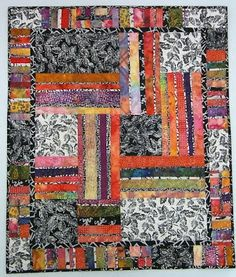 """Exuberant Color: Quilts pieced with uneven width strips. """"Candy Color."""""""