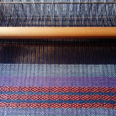 On the loom. I have woven a length of fabric for cushion covers. Now working on fabric for my Little zipper bags in preparation for September when my shop will reopen. #writtenincloth #weaving #handwovenfabric #handdyedyarn #weaversofinstagram #textiles #textiledesign #handwoventextiles