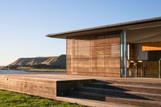 Built as a holiday home, this Mahia Peninsula holiday home demonstrates the beauty of man-made structures that work alongside the natural environment. http://www.homeinspiration.co.nz/building/homes/2016/01/26/a-timber-clad-home-thats-at-one-with-nature/