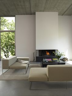 *living room design, modern interiors, architecture, minimalism* - C. Patey Arch., House in Chambery, France, Photography by Eugeni Pons. Neutral color sofa, Ile, designed by Piero Lissoni for Living Divani.