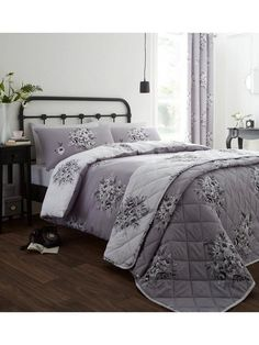 Catherine Lansfield Floral Bouquet Duvet Cover and Pillowcase Set in Double and King SizesBringing a taste of the great outdoors into the home, floral bedding has an eternal charm that can brighten up any bedroom.This delightful duvet cover and pillowcase set from Catherine Lansfield proves that, with gorgeous black and white bouquets against a soft grey base. On the reverse, the same print on a crisp white background adds to the timeless, enduring appeal.Easy to care for, it perfectly…
