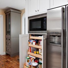 built-in microwave with built-in pantry below.  Yours would not be nearly this big ;)  Probably be able to fit side spice rack on each side
