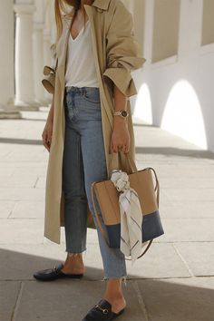 cut off jeans, white t-shirt, camel trench coat, beige and navy totes, slide on loafers