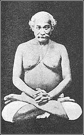 From a seated posture, one foot is placed on top of the opposite thigh with sole facing upward and heel close to the abdomen. The other foot is then placed on the opposite thigh in a symmetrical way.