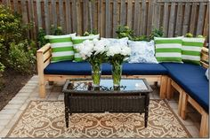 Bakyard Bliss DIY Sectional - isn't this stunning! I love those green pillows, blue cushions with the wood sectional frame. Outdoor sectional diy plans project easy furniture ana-white.com