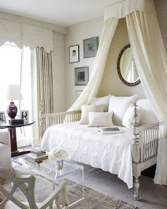 beautiful all white room with lovely details.