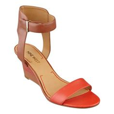 """A comfortable ankle strap tops a multi-colored, open-toe wedge sandal that flaunts a sleek silhouette. Adjustable buckle closure. Padded footbed for all-day comfort. Leather upper. Man-made lining and sole. Imported. Multi-colored stacked  2 1/2"""" heels. Open-toe sandals."""