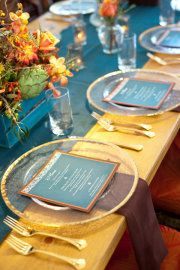 The colors in this display are gorgeous,  The flowers with their orange and yellow and place setting with yellow and blue!! Be U Ti Ful! #reception ideas, #fall wedding