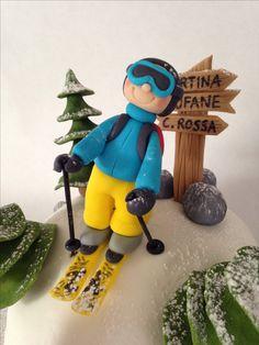 Fondant skier cake topper