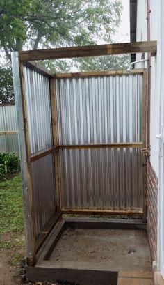 Wood and corrugated iron outside shower