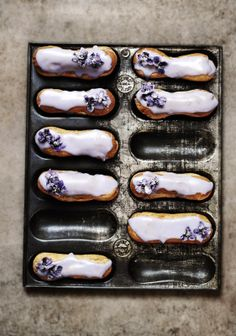 ..Twigg studios: violet and lemon eclairs. These would be perfect to tint icing to match your decor/event. Sugared flowers add a special touch.