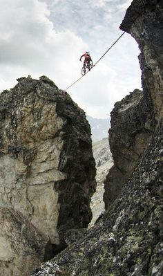 Kenny Belaey rides his trials bike along a 59-foot-long slackline, 367 feet above a gorge at an altitude of 8,858 feet.