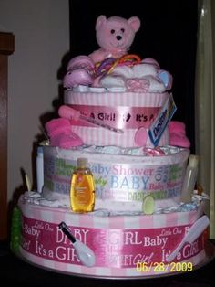 Baby girl diaper cake: Ingredients:  85 disposable diapers (sz. 1) (4) receiving blankets (2) sets of diaper pins Baby bottle bank:  Contents -  vinyl bib, snack cup, powdered