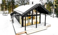This log villa in Finland can withstand harsh winters and temperatures down to -30°C (-22°F) using geothermal energy for heat