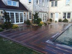 Mahogany decking pool surround.