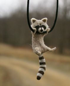 Tiny Raccoon Necklace by motleymutton.