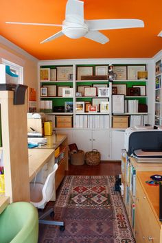 The orange ceiling adds a great pop of color that draws the eye upward.